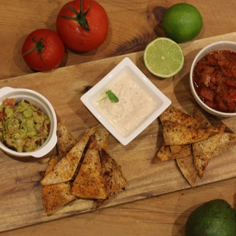 Guacamole, salsa, and soured cream dip with nachos - £3.00